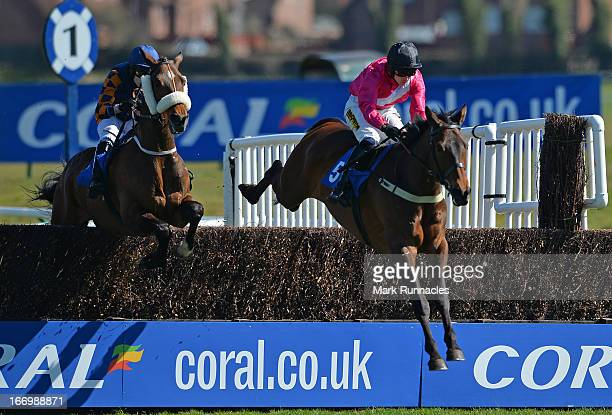 Jockey Ryan Mania competes during the Hillhouse Quarry Handicap Steeple Chase his first race meeting since his fall after winning the Grand National...