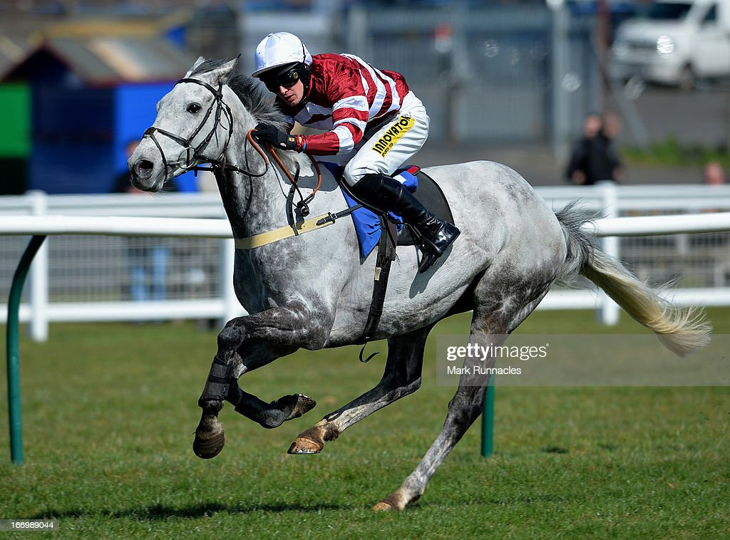Jockey Ryan Mania competes during the (13.40) Play Golf At Close House Handicap Hurdle Race, his first race meeting since his fall after winning the Grand National last month, at Ayr racecourse on April 19, 2013 in Ayr, Scotland.