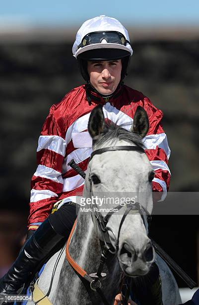 Jockey Ryan Mania competes during the Play Golf At Close House Handicap Hurdle Race his first race meeting since his fall after winning the Grand...