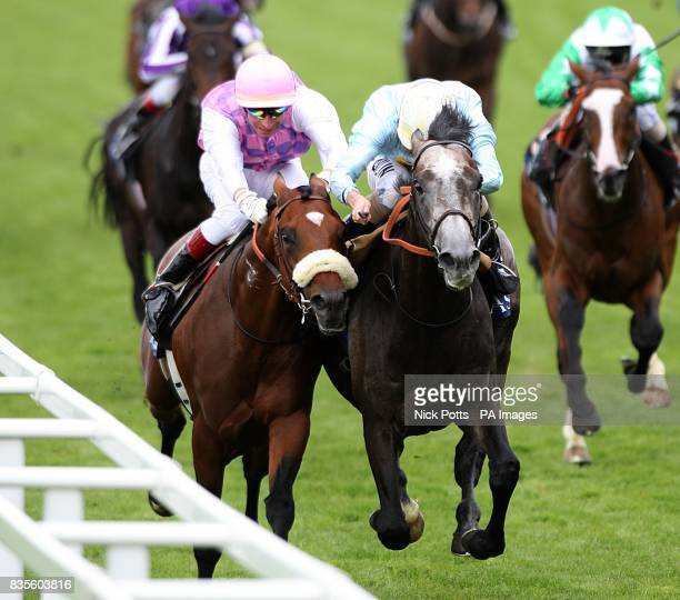 Jockey Ryan Moore on Glass Harmonium jostles for position with Cashelgar ridden by Gerald Mosse on his way to winning the Hampton Court Stakes at...
