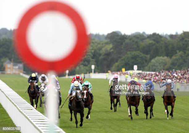 Jockey Ryan Moore on Glass Harmonium leads the field down the home straight to win the Hampton Court Stakes at Ascot Racecourse Berkshire