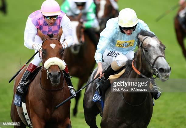 Jockey Ryan Moore on Glass Harmonium wins the Hampton Court Stakes ahead of Cashelgar ridden by Gerald Mosse at Ascot Racecourse Berkshire