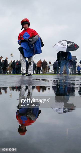 Jockey Sam Hitchcott returns to the weighing room after finishing on a wet day at Bath racecourse on August 9 2017 in Bath England