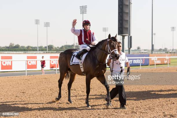 Jockey Sam Hitchcott riding One Man Band wins the Godolphin Mile during the Dubai World Cup Day at Meydan Racecourse on March 26 2016 in Dubai United...