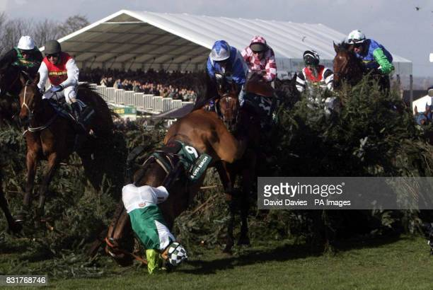 Jockey Sam Thomas falls from Silver Birch at the Chair during the John Smith's Grand National at Aintree racecourse Saturday April 8 2006