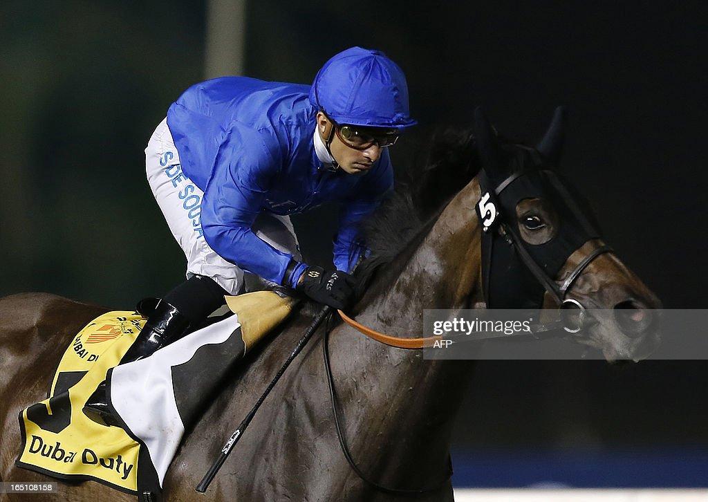Jockey Silvester De Sousa leads Sajjhaa, owned by Godolphin stables, to win the Dubai Duty Free in the Dubai World Cup mee, the world's richest race, at Meydan race track in Dubai March 30, 2013. AFP PHOTO/KARIM SAHIB