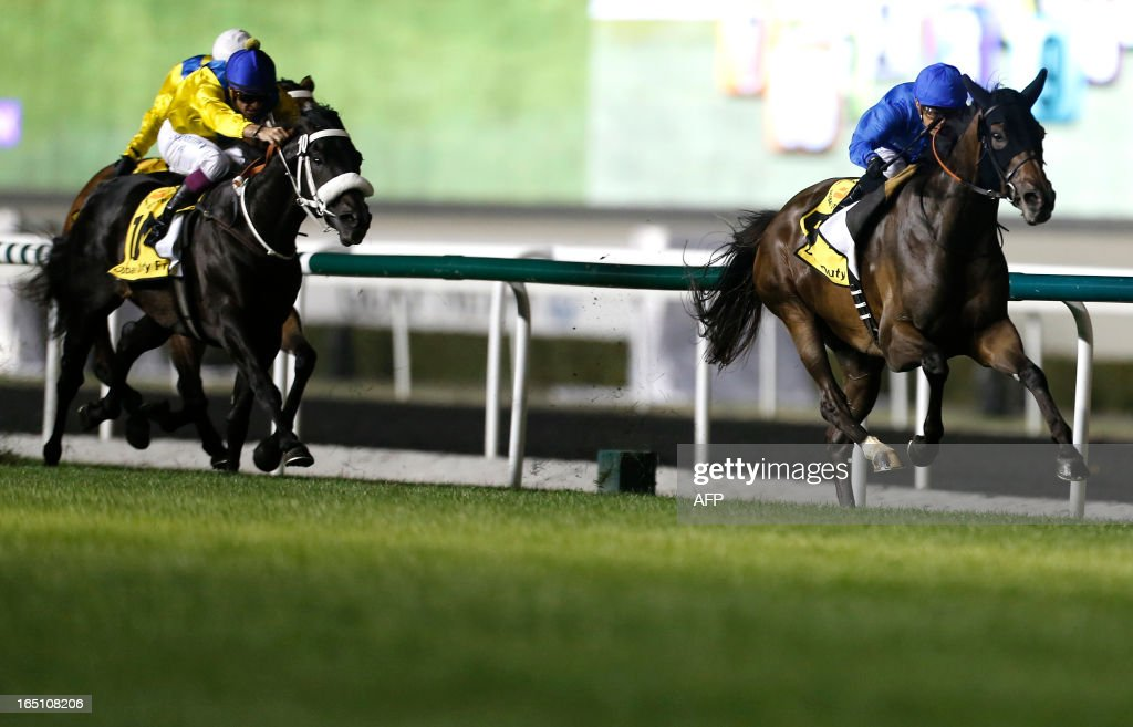 Jockey Silvester De Sousa (R) leads Sajjhaa, owned by Godolphin stables, to win the Dubai Duty Free in the Dubai World Cup mee, the world's richest race, at Meydan race track in Dubai March 30, 2013. AFP PHOTO/KARIM SAHIB