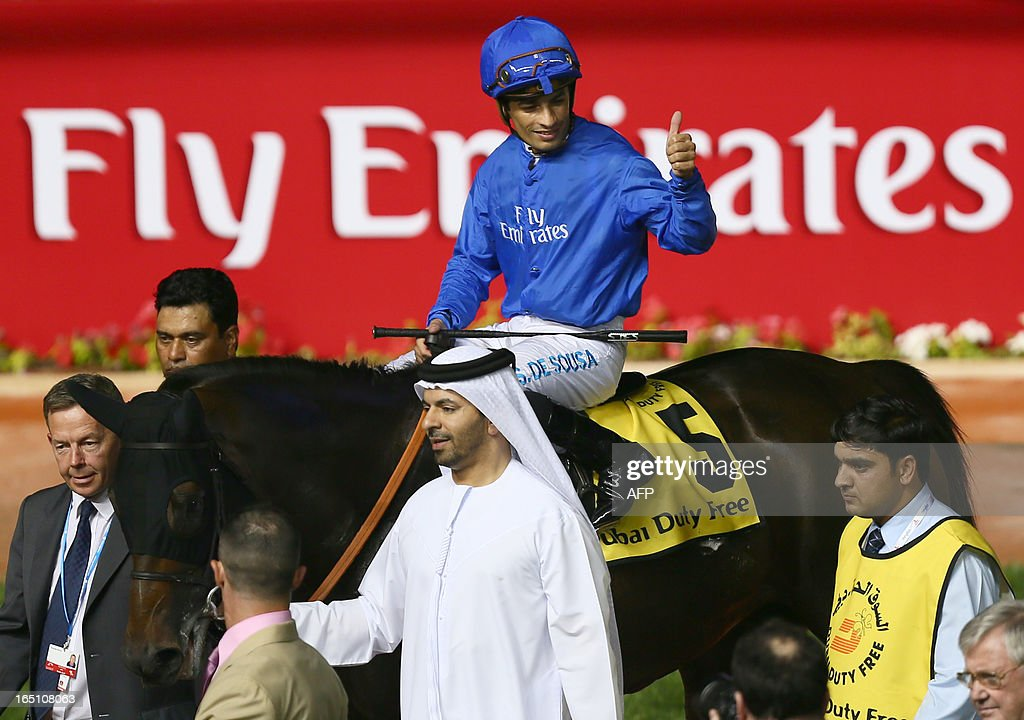 Jockey Silvester De Sousa on Sajjhaa, owned by the Godolphin stables, celebrates his win in the Dubai Duty Free part of the Dubai World Cup meet, the world's richest race, at Meydan race track in Dubai March 30, 2013.