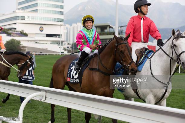 Jockey Silvestre de Sousa riding Horse Of Fortune participate in the Race 8 LONGINES Hong Kong Cup at Sha Tin Racecourse during the Hong Kong...