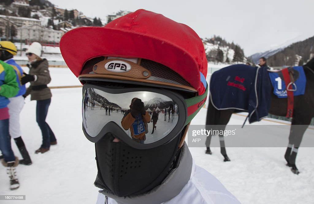 PEDRERO---A jockey stands by his horse ahead of a race at the White Turf racing event in St. Moritz on February 3, 2013. The races are held on the frozen lake of the Swiss mountain resort.