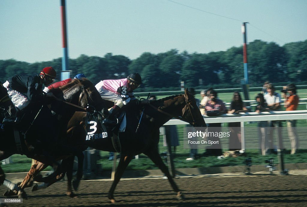 Jockey Steve Cauthen rides on Affirmed who takes the lead on jockey Jorge Velasquez and Alydar during the Belmont Stakes to win the Triple Crown on...