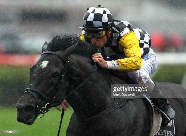 Jockey Steven Arnold riding So You Think wins Race Five the Longines Mackinnon Stakes during Victoria Derby Day at Flemington Racecourse on October...