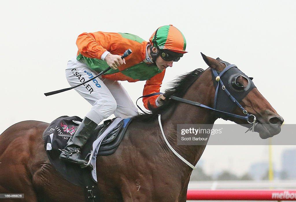Jockey Thomas Sadler riding General Truce wins race 7 Yarraville Handicap during Melbourne Racing at Flemington Racecourse on April 13, 2013 in Melbourne, Australia.