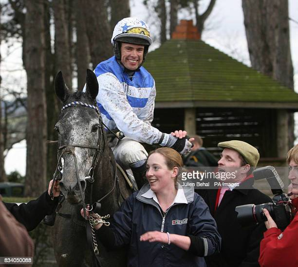 Jockey Timmy Murphy celebrates his victory on Barker in The Pierse Hurdle at Leopardstown Racecourse