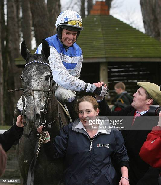 Jockey Timmy Murphy shakes hands with James Barrett after claiming victory on Barker in The Pierse Hurdle at Leopardstown Racecourse