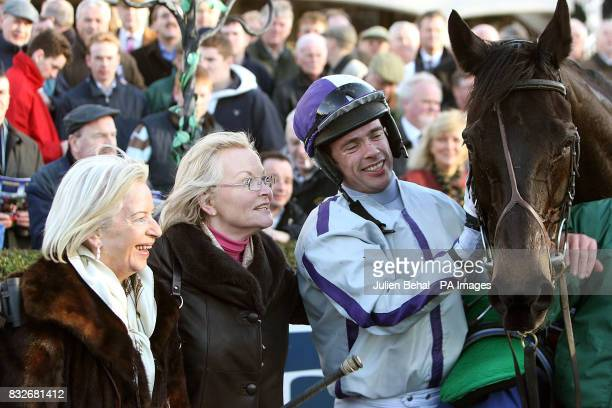 Jockey Timmy Murphy with Point Barrow after winning the Pierse Leopardstown Handicap Chase with MrsPhil CluneHughes and MrsAnn Nolan at Leopardstown...