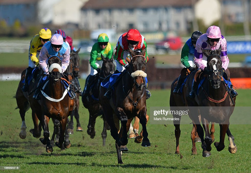 Jockey Tom O'brien (red & green stripes) riding Regal Diamond in the Alice Abbott 60th Birthday Standard Open National Hunt Flat Race, at Ayr racecourse on April 19, 2013 in Ayr, Scotland.