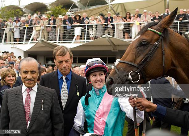 Jockey Tom Queally with owner Khalid Abdulla and trainer Sir Henry Cecil after winning the Qipco Sussex Stakes on Frankel at Goodwood racecourse on...