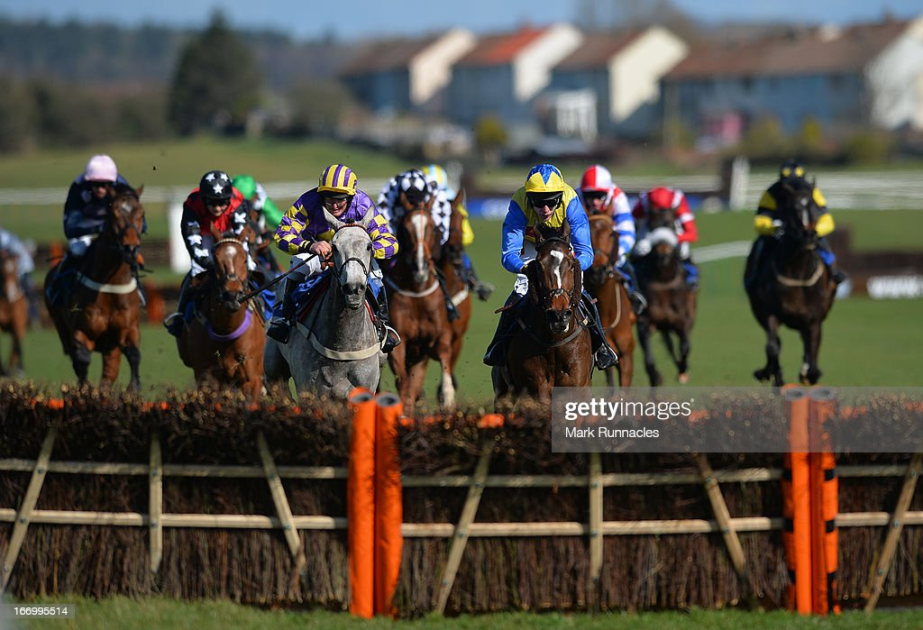 Jockey Tom Scudamore riding Amigo (blue & yellow hat) on his way to winning the Befriend Johnnie Delta Racing On Facebook Handicap Hurdle Race (4:25), at Ayr racecourse on April 19, 2013 in Ayr, Scotland.