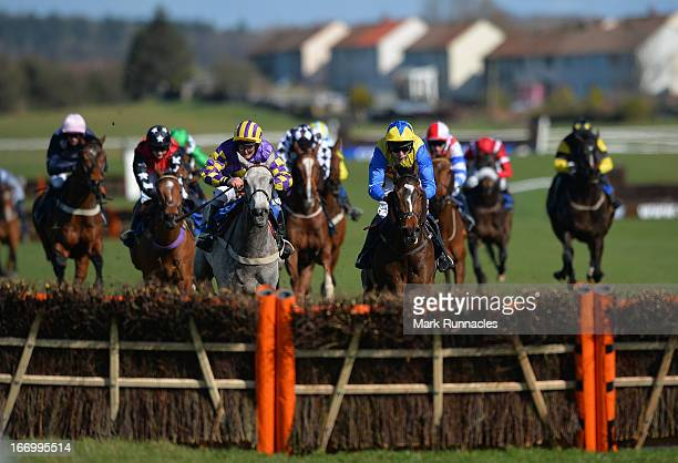 Jockey Tom Scudamore riding Amigo on his way to winning the Befriend Johnnie Delta Racing On Facebook Handicap Hurdle Race at Ayr racecourse on April...