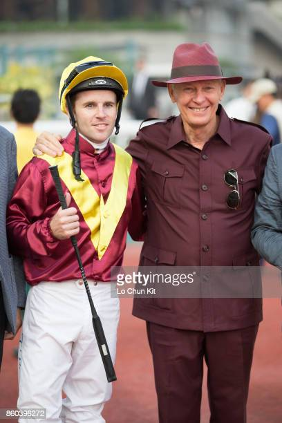 Jockey Tommy Berry and trainer John Moore celebrate after Green Card winning Race 10 Woodpecker Handicap at Sha Tin racecourse on September 16 2017...