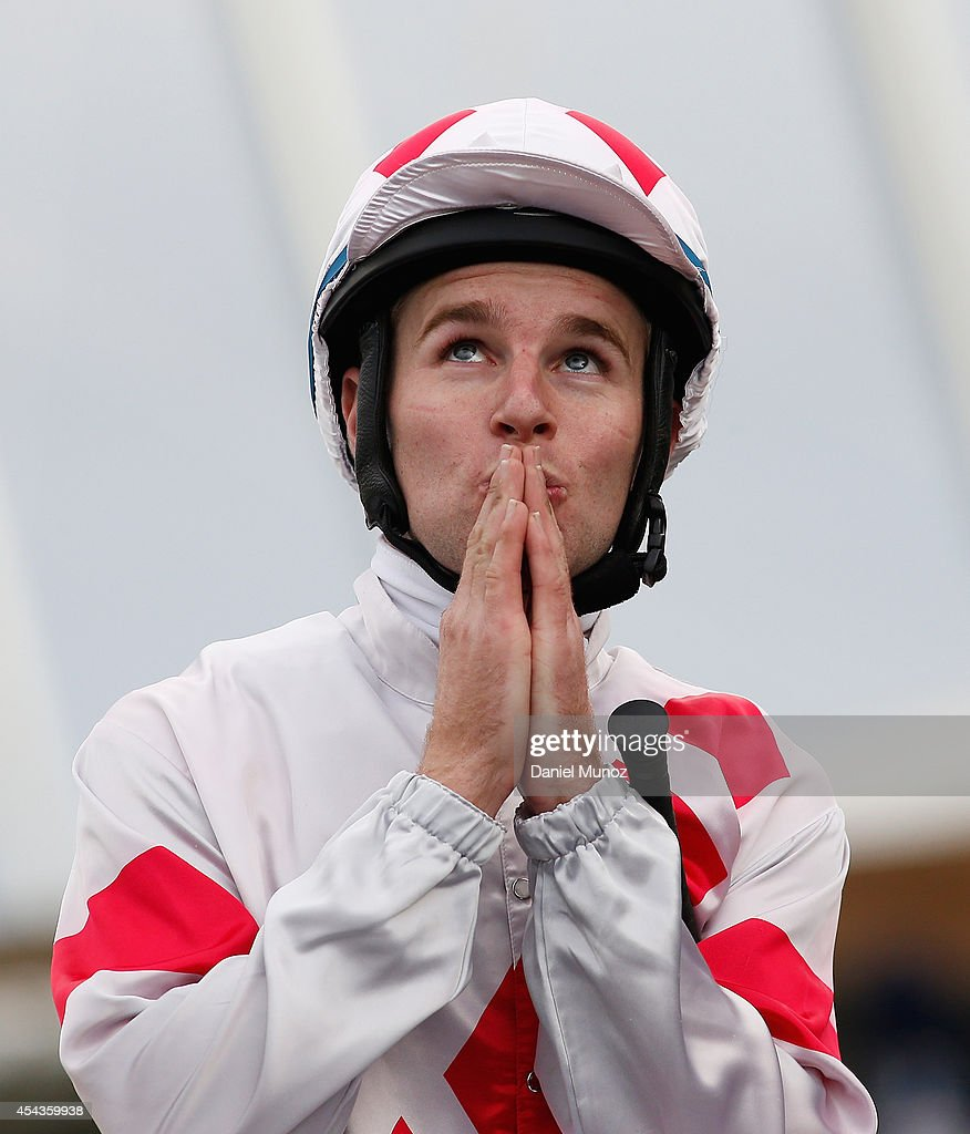 Jockey Tommy Berry reacts after winning Race 7 'Premier's Cup' during Sydney Racing at Rosehill Gardens on August 30, 2014 in Sydney, Australia.