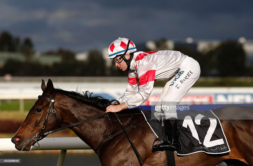 Jockey Tommy Berry rides Greatwood to win Race 7 'Premier's Cup' during Sydney Racing at Rosehill Gardens on August 30, 2014 in Sydney, Australia.