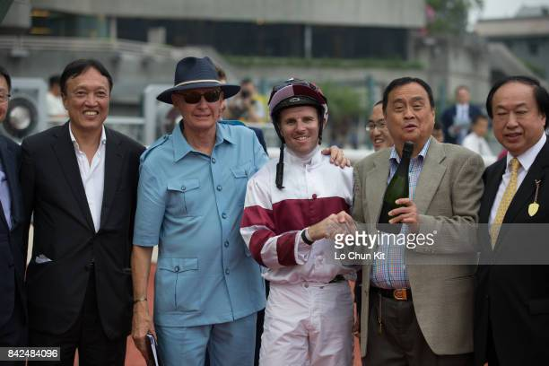 Jockey Tommy Berry trainer John Moore and owners celebrate after Hair Trigger winning Race 7 Cotton Tree Handicap at Sha Tin racecourse on September...