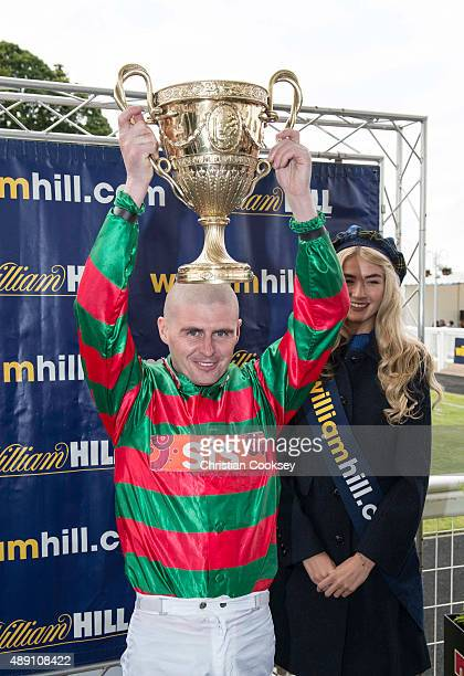 Jockey Tony Hamilton with the Gold Cup after riding Don't Touch to victory in the William Hill Ayr Gold Cup on September 19 2015 in Ayr Scotland