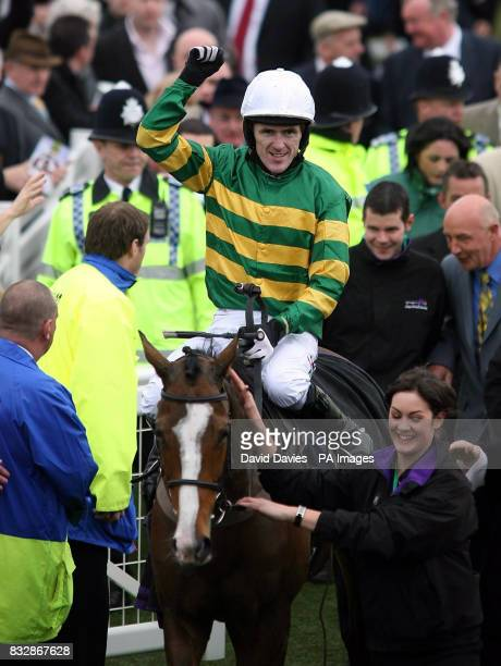 Jockey Tony McCoy celebrates his victory on Wichita Linesman in the Brit Insurance Novices' Hurdle on the final day of the Cheltenham Festival at...