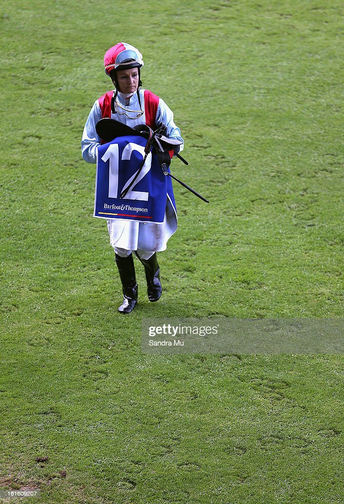 Jockey Trudy Thornton walks back to scale during the Auckland Twilight races at Ellerslie Racecoourse on February 13, 2013 in Auckland, New Zealand.