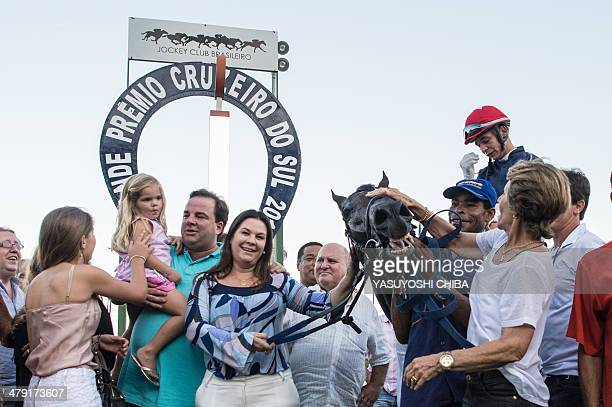 Jockey Vagner Borges celebrates on his race horse Bal A Bali after the winning in Rio de Janeiro's G1 derby Cruzeiro do Sul in Rio de Janeiro Brazil...