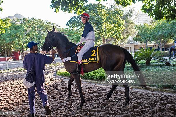 Jockey Vagner Borges rides his race horse Bal A Bali after the winning in Rio de Janeiro's G1 derby Cruzeiro do Sul in Rio de Janeiro Brazil on March...