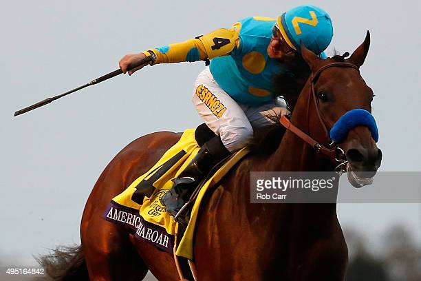 Jockey Victor Espinoza celebrates after riding American Pharoah to victory in the Breeders' Cup Classic at Keeneland Racecourse on October 31 2015 in...