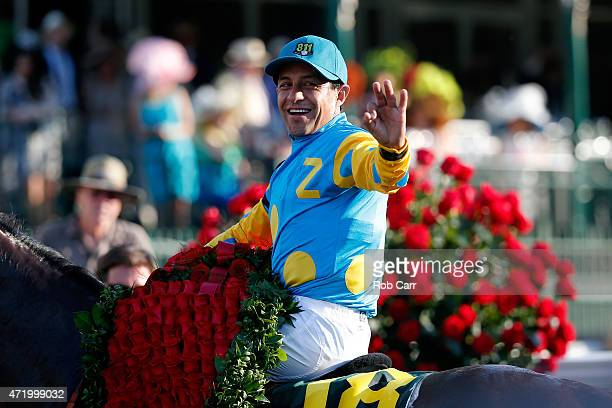 Jockey Victor Espinoza celebrates atop of American Pharoah in winners circle after winning the 141st running of the Kentucky Derby at Churchill Downs...
