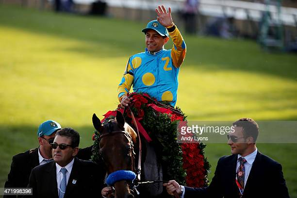 Jockey Victor Espinoza celebrates atop of American Pharoah on his way winners circle after winning the 141st running of the Kentucky Derby at...