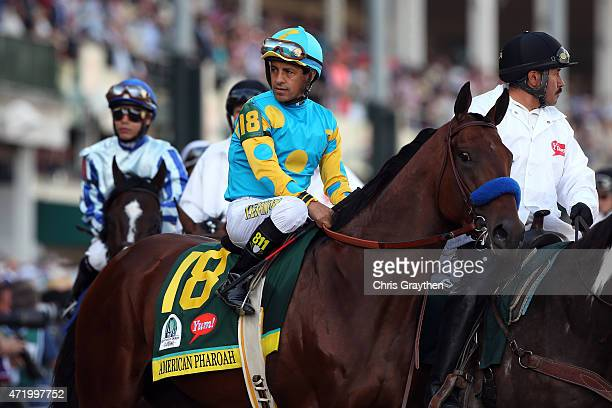 Jockey Victor Espinoza guides American Pharoah on track prior to the start of the 141st running of the Kentucky Derby at Churchill Downs on May 2...