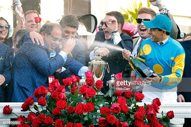 Jockey Victor Espinoza of American Pharoah celebrates by spraying owner Ahmed Zayat with champagne in winners circle after winning the 141st running...
