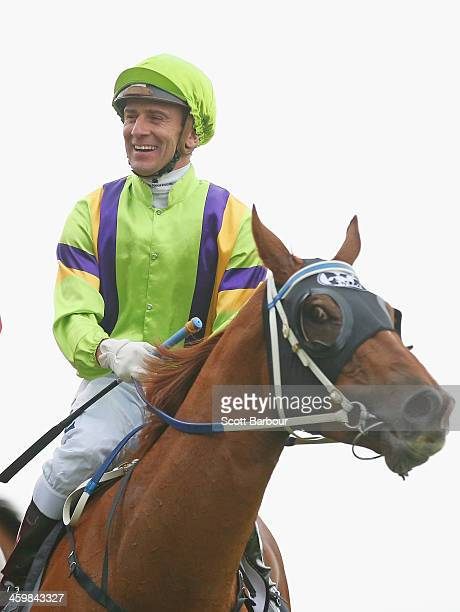 Jockey Vlad Duric after riding Flamberge to win race 6 the Standish Handicap during New Years Day racing at Flemington Racecourse on January 1 2014...