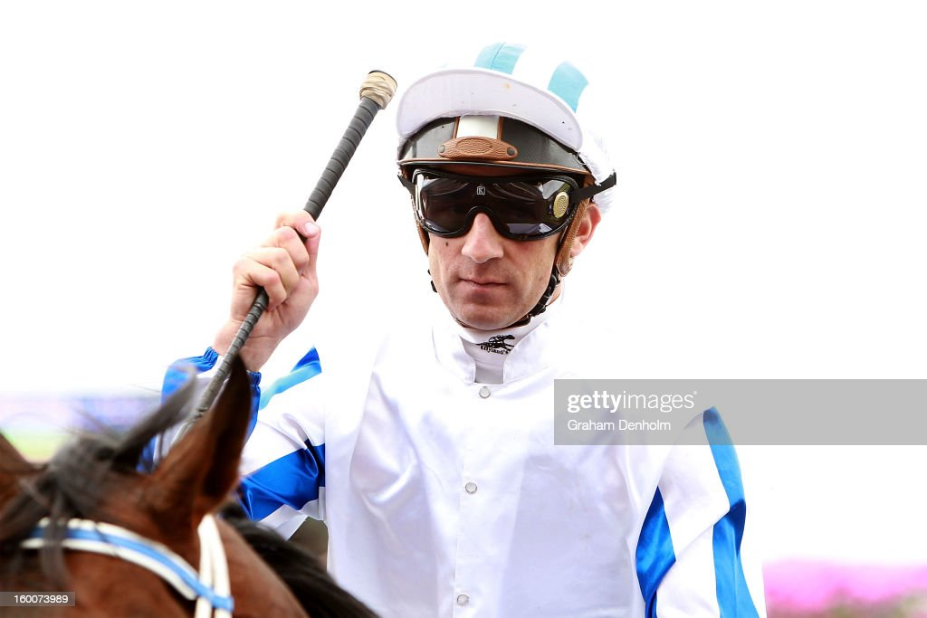 Jockey Vlad Duric celebrates after riding Dissident to victory in race three the Patinack Farm Blue Diamond Preview during Australia Day Races at Caulfield Racecourse on January 26, 2013 in Melbourne, Australia.