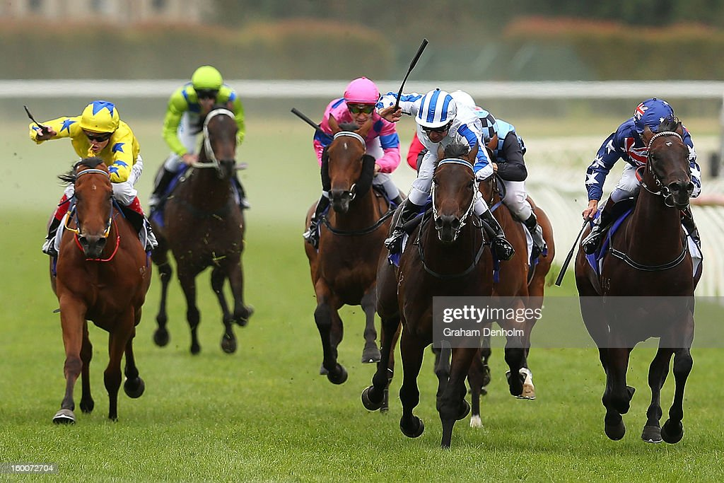 Jockey Vlad Duric (C) leads the field riding Dissident to victory in race three the Patinack Farm Blue Diamond Preview during Australia Day Races at Caulfield Racecourse on January 26, 2013 in Melbourne, Australia.
