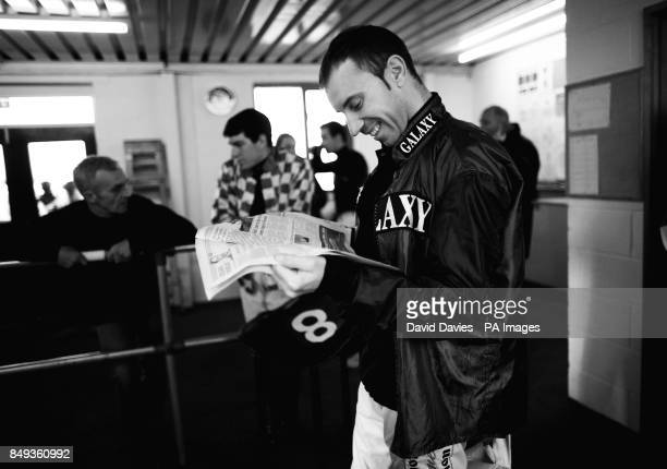 PHOTOSHOP* Jockey Wayne Hutchinson reads the Racing Post in the weighing room at Ludlow Racecourse