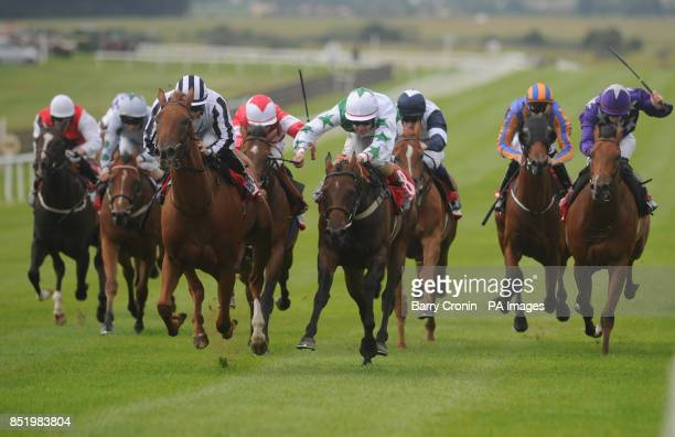 Jockey Wayne Lordan rides Come to Heel to victory in The Irish Field Curragh Stakes Race during the Galileo Futurity Stakes Day at the Curragh...