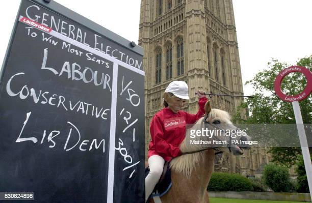 A jockey wearing a Prime Minister Tony Blair mask takes part in a 'onehorse race' outside the Houses of Parliament in London Ladbrokes took the...