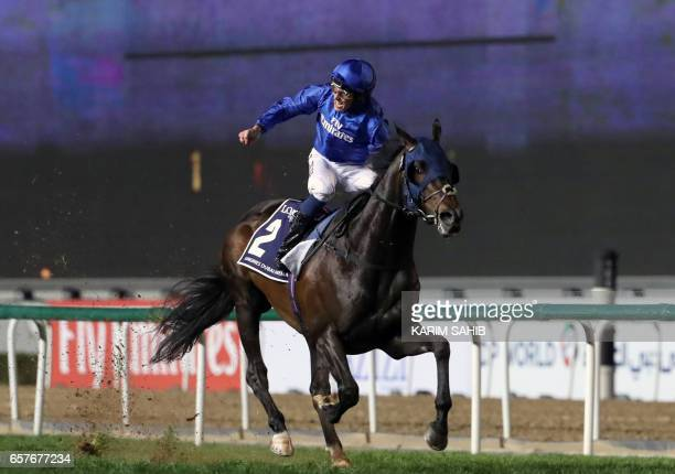 Jockey William Buick rides Jach Hobbs to win the Longines Dubai Sheema Classic at the Dubai World Cup in the Meydan Racecourse on March 25 2017 in...