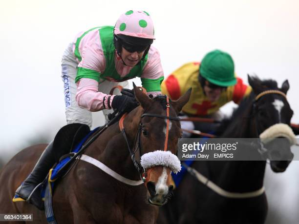Jockey William Kennedy on Divine Gift leads Tony McCoy on Black Beauty during the Andy Don Memorial Novices' Chase