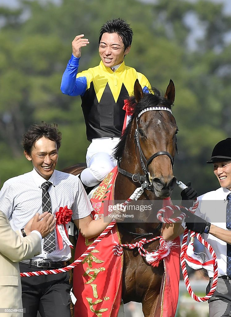 Jockey Yuga Kawada (C) celebrates after riding Makahiki to victory in the Japanese Derby at Tokyo Racecourse on May 29, 2016. The Deep Impact-sired Makahiki became the top 3-year-old in all of Japan as jockey Yuga Kawada and trainer Yasuo Tomomichi won their first Derby.