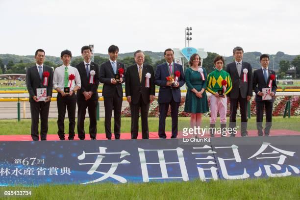 Jockey Yuga Kawada trainer Yasutoshi Ikee and owner Hajime Satomi all smile to cameras at the Yasuda Kinen trophy presentation ceremony at Tokyo...