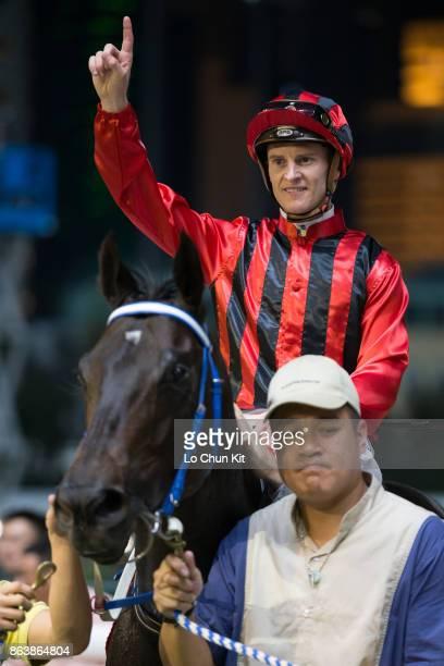 Jockey Zac Purton riding Gonna Run wins the Race 8 Sutherland Handicap at Happy Valley Racecourse on October 18 2017 in Hong Kong Hong Kong