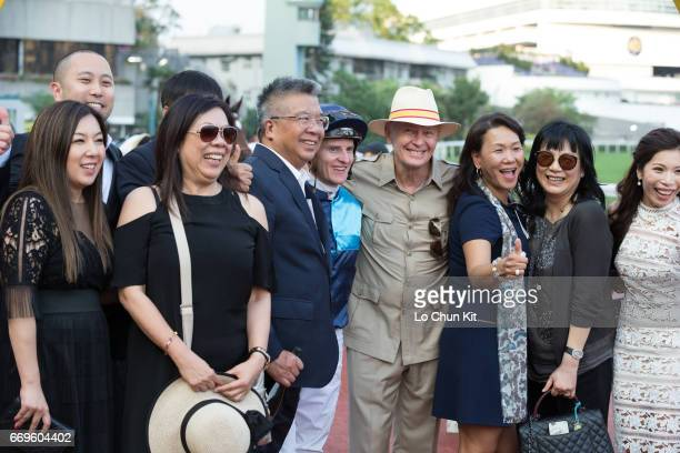 Jockey Zac Purton trainer John Moore and owners celebrate after winnimg Race 10 Siu Ma Shan Handicap at Sha Tin racecourse on April 17 2017 in Hong...